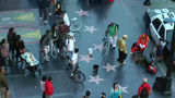 HOLLYWOOD, California - CIRCA 2014: Tourists Gathe stock footage