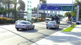 LAX Airport Entrance With Traffic And Signs stock footage
