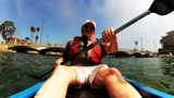 Mature Man Kayaking In Bay Away From Bridge stock footage