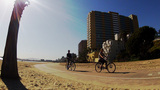 Sunny Day Beach Bike Riders Wide Angle Long Beach stock footage