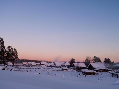 Village is illuminated setting sun. Time Lapse. 4x Footage