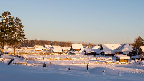 Houses under snow at sunset. Time Lapse Footage