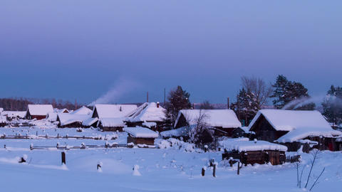 Village houses in winter at sunset. Time Lapse Footage