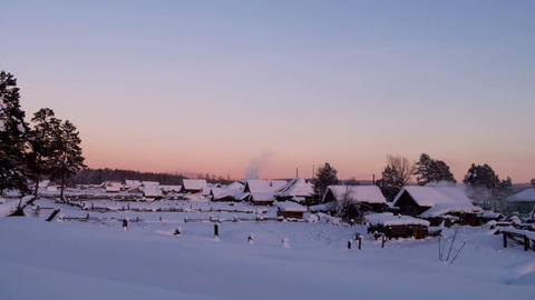 Winter village at sunset. Time Lapse. 1280x720 Footage