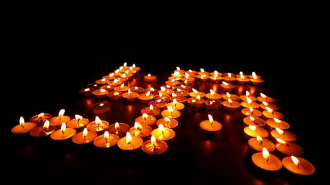 Candles Swastika Buddhist Dolly stock footage