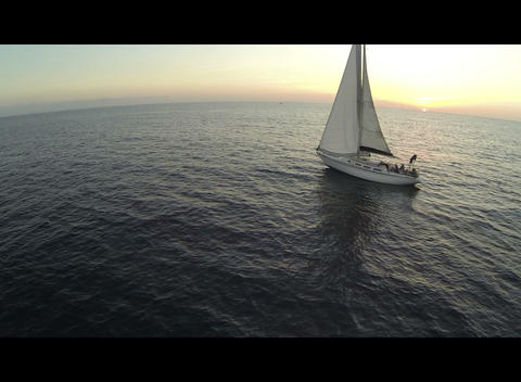 A Sailboat Floating At Sunset stock footage