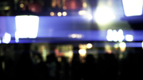 abstract blur busy crowd silhouette on business street at night Animation