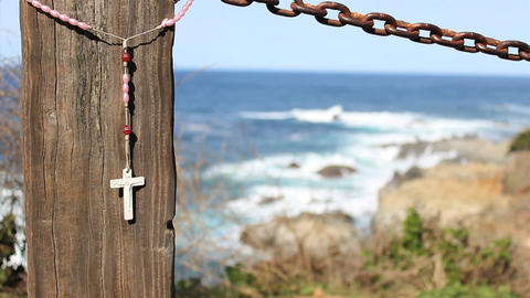 Cross Blowing On Fence By The Ocean At Big Sur Footage