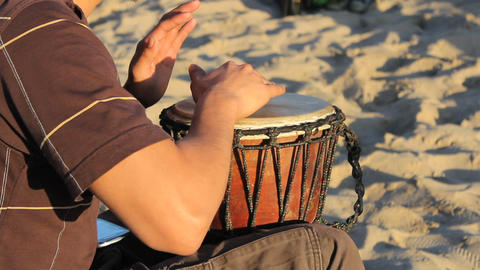 Young Man Playing Djembe Drum On The Beach Footage