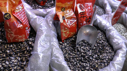 Sags Of Black Pumpkin Seed On Sale During Chinese  stock footage