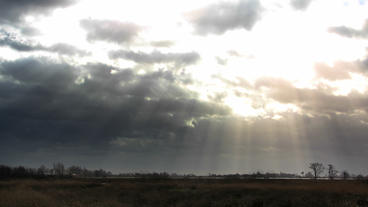 God Rays clouds with sunbeams over countryside Tim Footage