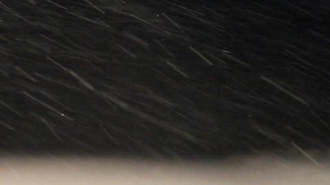 Snowstorm. snow dust in motion. Abstract Backgroun Footage