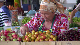 Lady sells fruit at bazaar in Central Asia Footage