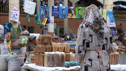 Veiled lady sells bread at bazaar in Central Asia Footage