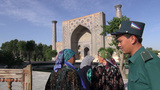 Guard lets in ladies at Regestan in Samarkand Footage