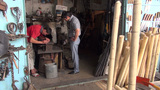 Selling knives at bazaar Uzbekistan Footage