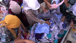 Buying clothing at bazaar Central Asia Footage