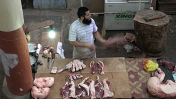 Butcher at market in Central Asia Footage