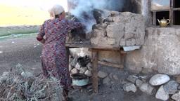 Baking fresh bread in rural setting Tajikistan Footage
