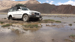 Landcruiser jeep stuck in swamp Central Asia Footage