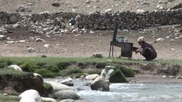 Preparing tea near water stream in Pamirs Footage