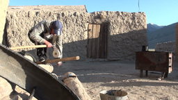 Worker uses hand powered tools to sharpen axe Footage