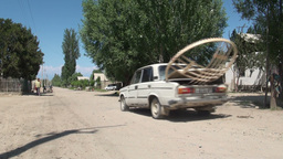 Transporting yurt in old Lada Footage