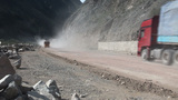 Chinese road crew on dusty road in Kyrgyzstan Footage
