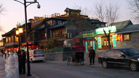 a main street area in houhai lake area in the even Footage