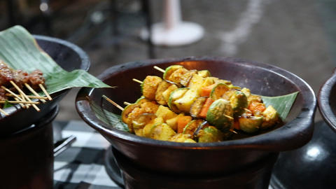 a look at some satay dishes at an outdoor indonesi Footage