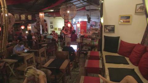 the nightlife scene in labuan bajo at a restaurant Footage
