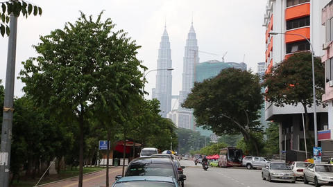 Wide shot of the Petronas Towers from Kuala Lumpur Live Action