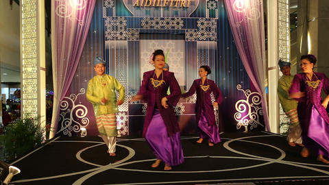 Malaysian dancers perform close front angle Live Action