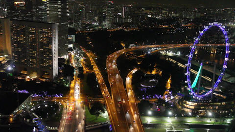 Evening aerial view of the Singapore flyer ferris  Footage