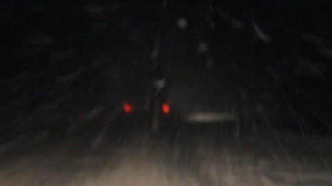 night snowstorm. the car moves on snow with poor v Footage