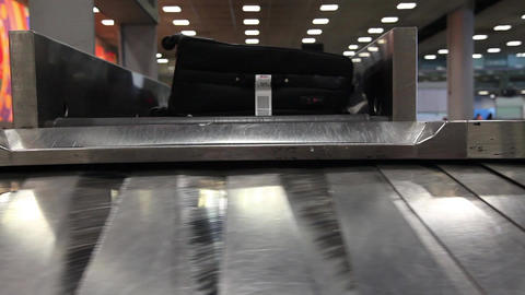 Airport baggage belt with moving luggage Footage