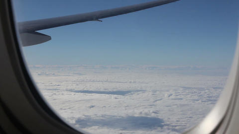 Clouds and sky as seen through window of an aircra Footage