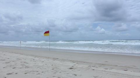 Lifeguard Flag On Sunny Gold Coast Beach With Surf stock footage