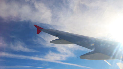 Wing Of Flying Airplane And Sun Shining stock footage