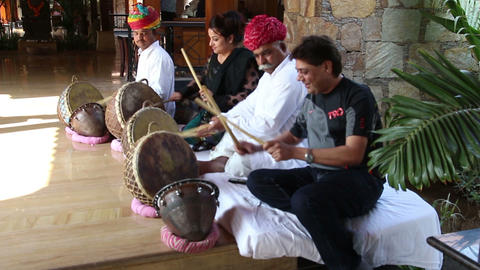 artists and tourists play drums in India Live Action