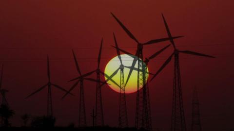 wind farm - turning windmills on background of set Footage