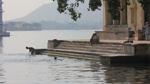 Indian people bathing in Pichola Lake - Udaipur In Footage