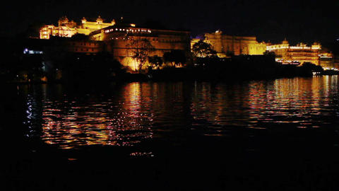 palace on lake in Udaipur at night - India Footage