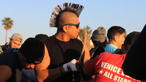 Man With Mohawk Playing Cowbell At Party Footage