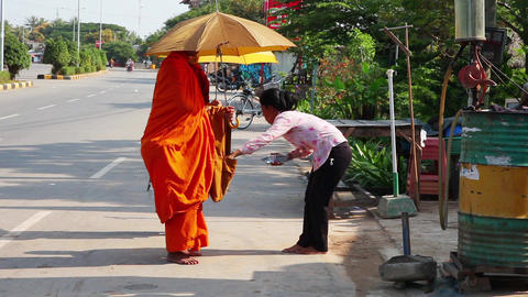 Monks Receive Food. Buddha stock footage