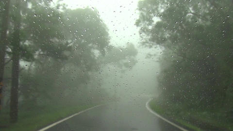 Driving On Mountain Road In Fog And Rain stock footage