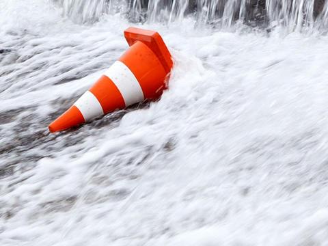 Orange traffic cone under a waterfall. 640x480 Footage