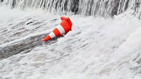 Water flows on the orange traffic cone Footage