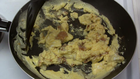 Preparing Scrambled Eggs stock footage