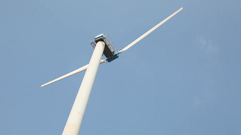 Wind turbine generates electricity on a sunny day Footage